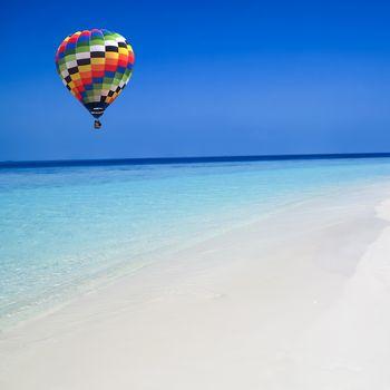 Hot air balloon travel over the sea
