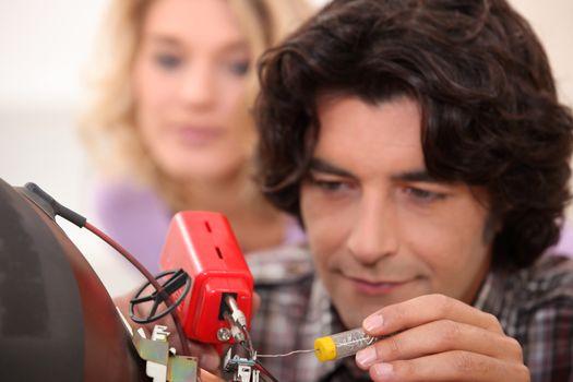 Man repairing television