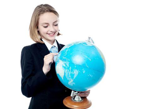 Business leader holding globe map