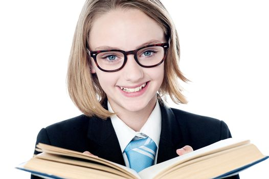 Young business leader reading a book