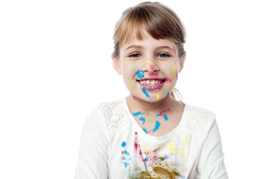 Smiling cute kid with painted face