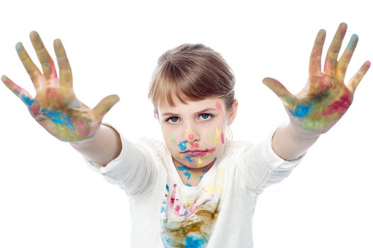 Serious faced girl with painted hands