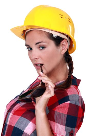 An alluring female construction worker with sunglasses.