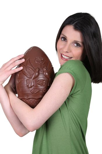 Woman holding a large chocolate Easter egg