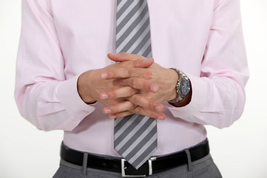 businessman with joined hands making presentation