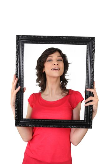 Brunette woman with black frame