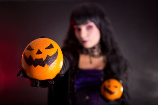Pretty witch in purple Halloween costume
