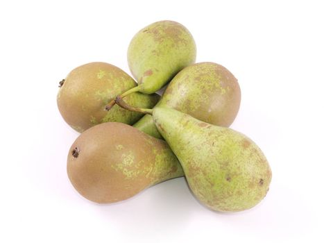 Close up of freshly picked organic pears on a white background.