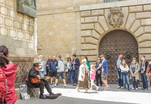 Traditional spanish guitar player in the gothic quarter of Barce