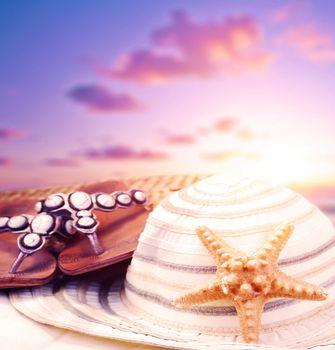 Beach accessories on sunset