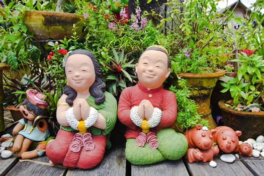 Terra cotta in characteristic of Thai traditional doll