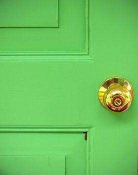 Gold door knob on green