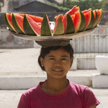 A Burmese woman selling watermelon at a temple in Bagan in Myanmar (Burma).