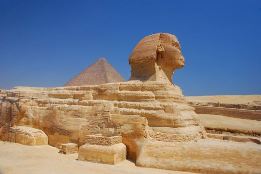 egypt sphinx in full side view with blue sky