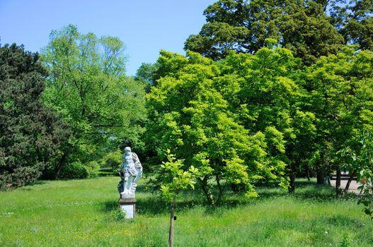 A sculpture of a man in Palmen Garten, Frankfurt am Main, Hessen