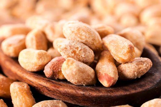 Peanuts on wooden spoon