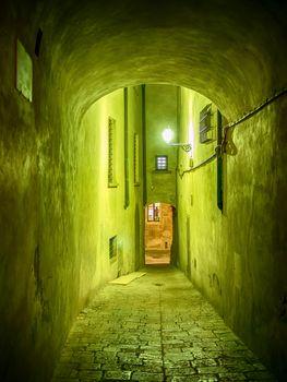 Narrow illuminated alley