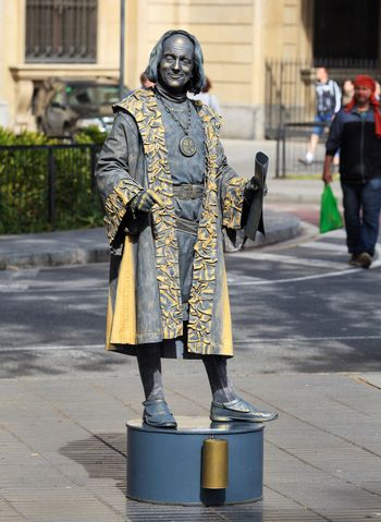 Human statue dressed as Christopher Columbus