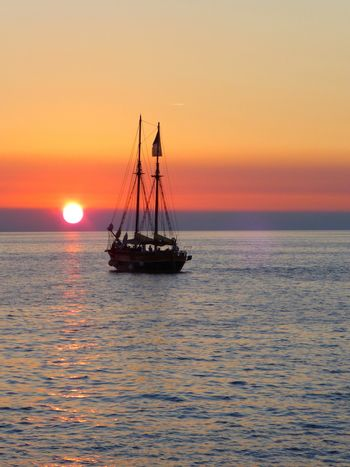 Boat going towards the sunset in the Adriatic Sea near Rovinj