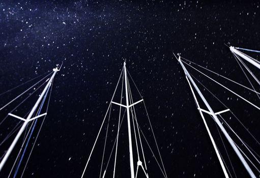 Sailboat mast on starry sky background