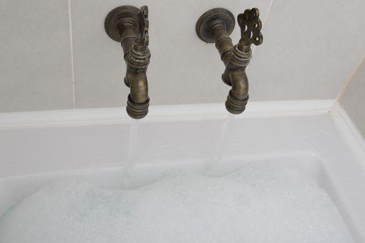 an old fashioned bathroom with bath
