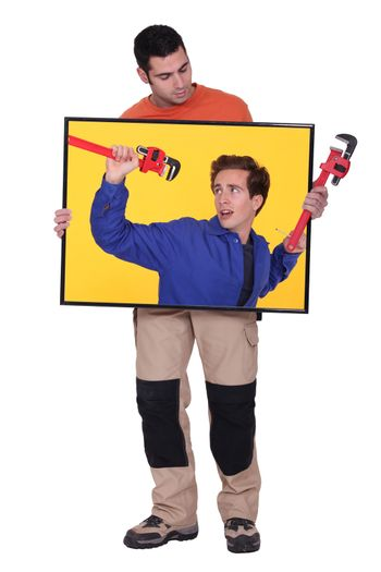 full-length shot of artisan holding picture of blue collar with spanner