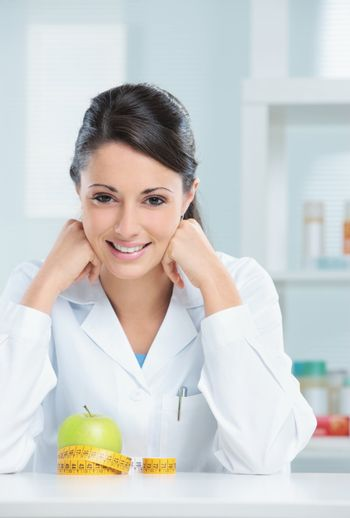 Portrait of a nutritionist female Doctor in her office