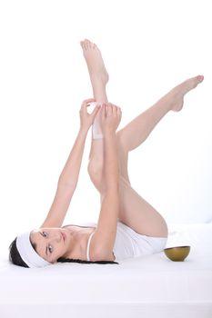 Young woman waxing her legs