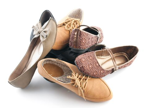 Pile of various female flat shoes
