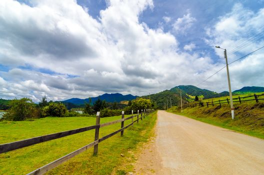 Rural country road and wooden fence in Neusa, Colombia