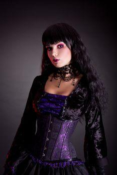 Portrait of beautiful gothic girl wearing Halloween costume