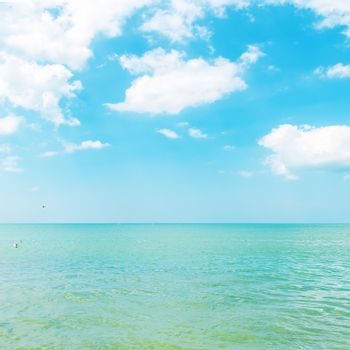 azure color sea and cloudy sky