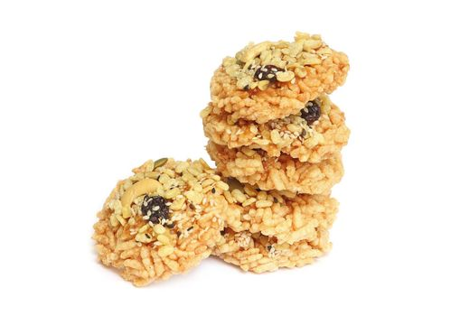 Crispy rice cracker with mixed seeds isolated on white background