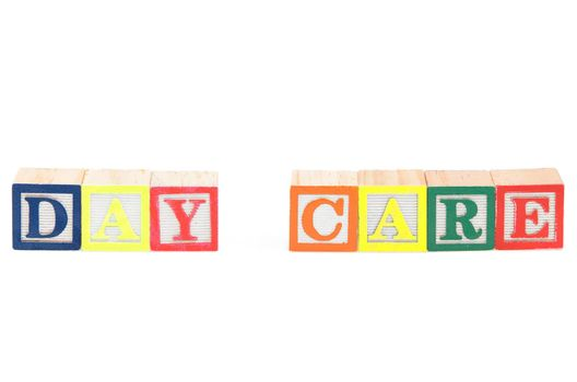Baby blocks spelling day care. Isolated on a white background.