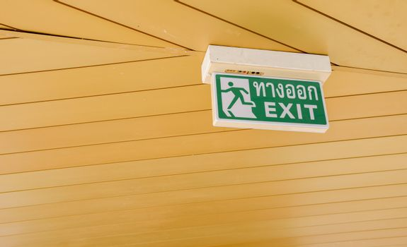 Exit sign on ceiling