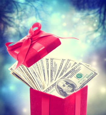 Hundred dollar bills in the red present box