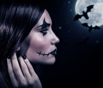 Terrifying witch in Halloween night