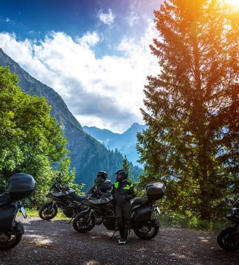 Biker resting in the mountains