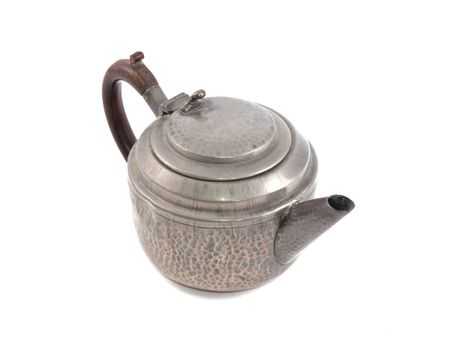 Pewter tea pot on a white background.