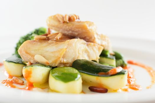 peace of fish with garnish