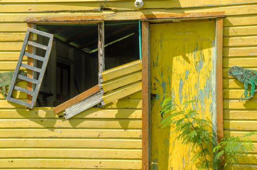 Old abandoned yellow building on tropical island of San Andres y Providencia, Colombia
