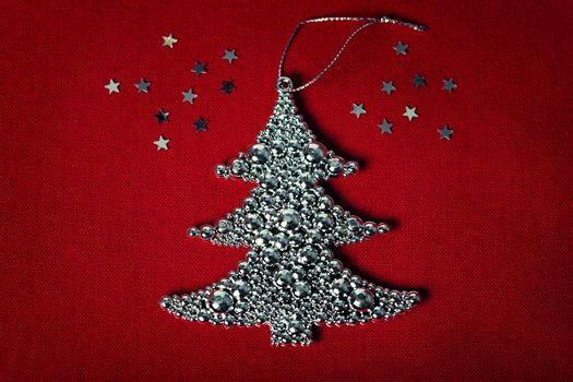 Metal christmas tree on fabric background