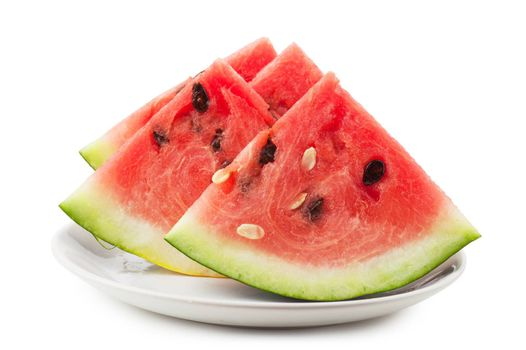 Macro view of fresh watermelon slices on a white plate