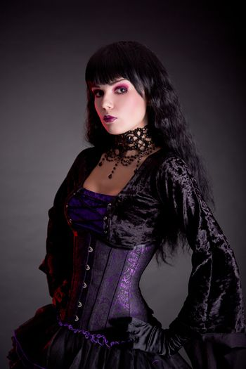Portrait of attractive gothic girl in elegant medieval costume