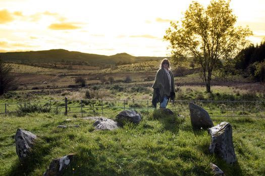 a female tourist at a stone circle in county Donegal Ireland