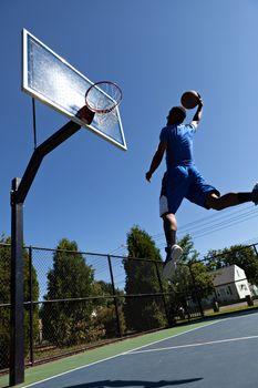 Man Dunking the Basketball