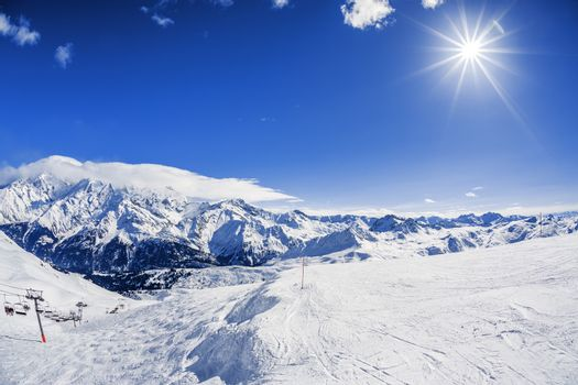 View of winter mountain landscape with sun