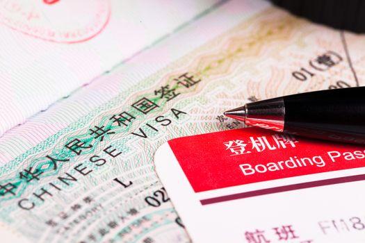 China visa in passport and boarding pass