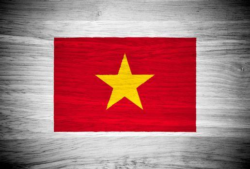 Vietnam flag on wood texture