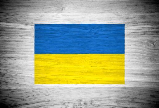 Ukraine flag on wood texture